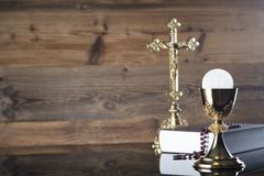 Catholic religion theme - Holy communion concept. Symbols of Christianity religion, brown wooden background. Place for text Stock Image