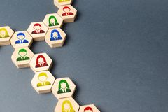Symbols of employees on the chains of hexagons. business connections. Team building, business organization and staff hierarchy. Symbols of employees on the royalty free stock photography