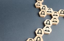 Symbols of employees on the chains of hexagons. The concept of business connections. Team building, business organization. And staff hierarchy. Human resources stock photos