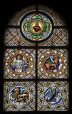 Symbols of the Evangelists. Stained glass window in the parish church of St. Peter and Paul in Oberstaufen, Germany Royalty Free Stock Images
