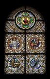 Symbols of the Evangelists. Stained glass window in the parish church of St. Peter and Paul in Oberstaufen, Germany Stock Images