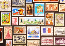 Symbols of France on its postage stamps. Monna Lisa, Tour Eiffel, Versailles, De Gaulle, the flag, Napoleon and other symbols on the french postage stamps Royalty Free Stock Photos