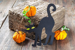 Symbols of Halloween: a black cat and a pumpkin made of paper Royalty Free Stock Photography