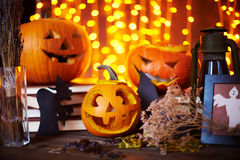 Symbols of Halloween. Carved pumpkins and other symbols of Halloween on sparkling background stock images
