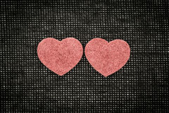 Symbols of hearts and love against a dark background Stock Photography