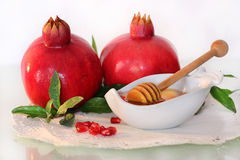 Symbols of holiday of Rosh Hashanah - honey and pomegranate Stock Photography
