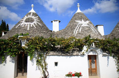 Symbols at Italian trulli in Alberobello. Alberobello is a small town and comune in the Italian province of Bari in Puglia and is famous for its unique trulli Stock Photo