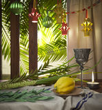 Symbols of the Jewish holiday Sukkot with palm leaves and candleSymbols of the Jewish holiday Sukkot with palm leaves Royalty Free Stock Images