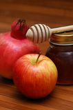 Symbols of jewish new year. Pomegranate, apple and honey - symbols of jewish new year Stock Image