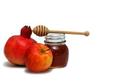 Symbols of jewish new year. Pomegranate, apple and honey - symbols of jewish new year Stock Photo