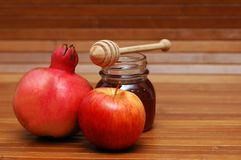 Symbols of jewish new year. Pomegranate, apple and honey - symbols of jewish new year Stock Images