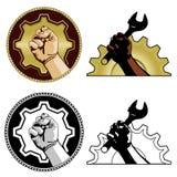 Symbols of labor. Gear and fist labor symbols in color, black & white Stock Image