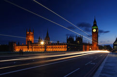Symbols of London - Big Ben, Westminster and bus. A double decker bus passing in front of Big Ben and the Houses of Parliament Royalty Free Stock Image