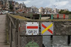 Signs symbols of the long distance trails at a bridge in le treport, normandy, france stock image