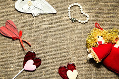 Symbols of love over burlap Royalty Free Stock Images