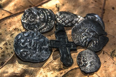 Symbols of the Middle Ages. Silver coins of the fourteenth century and a Christian cross Stock Images