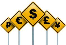 Symbols of monetary currencies in the world on the road signs. Stock Photo
