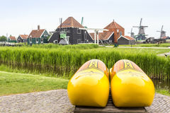 Symbols of The Netherlands - clogs and windmills Royalty Free Stock Photography