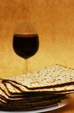 Symbols of Passover. Matsot and red wine - symbols of Passover Royalty Free Stock Image