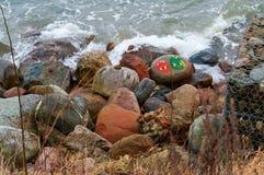 The symbols on the sea stones, graffiti on the stones. Graffiti on the stones, the symbols on the sea stones, on 26 November 2017, the Baltic sea, Pionerskiy Stock Photos