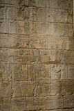 Symbols signs figures of the Pharaohs in Egypt, the wall in Luxo Stock Image
