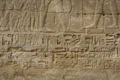 Symbols signs figures of the Pharaohs in Egypt, the wall in Luxo Stock Photography
