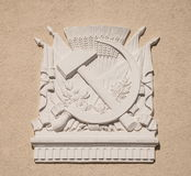 Symbols of the Soviet Union. Gypsum bas-relief depicts hammer and sickle - symbols of Soviet Union Royalty Free Stock Photo