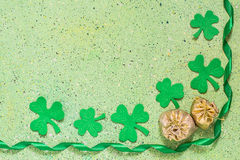 Symbols of St. Patrick's Day: shamrocks clover, bags of coins, g Stock Image
