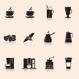 Symbolskaffe: kaffekvarnen rånar, kaffekorn Arkivbild
