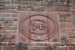 Symbolzeichen auf Schlosswand Stockfotos