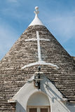Symbool in het kegeldak van Trullo in Alberobello, Apulia, Ita Stock Foto