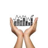 Symbool van bedrijfsgrafiek groeiende tendens op mensenhand Stock Foto's