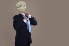 Symbool van een zakenman met doorsmeltingssyndroom royalty-vrije stock foto