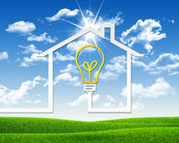 Symbool van gloeilamp en huis Stock Afbeelding