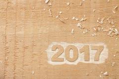 Symbool van nummer 2017 op houten textuur Stock Foto
