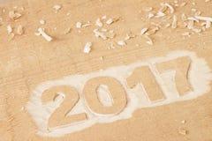 Symbool van nummer 2017 op houten textuur Stock Afbeeldingen