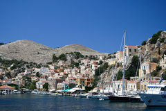 Symi bay. Image taken while entering the bay of Symi's capital town on a hot summer day stock images