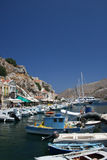 Symi bay. Image taken while entering the bay of Symi's capital town on a hot summer day royalty free stock photo