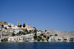 Symi bay. Image taken while entering the bay of Symi's capital town on a hot summer day Stock Photography
