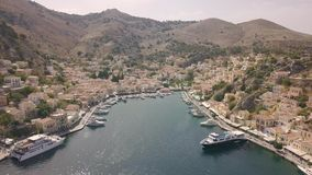 Symi, Greece, SEPTEMBER 2017 - Aerial view of small town with colorful houses stock video