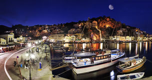 Symi Harbor By Night Stock Photo