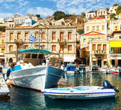 Symi island - Colorful houses and small boats at the heart of the village Royalty Free Stock Photos
