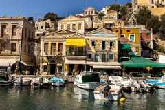 Symi Island, Greece - September 16, 2016: Waterfront seaside of. Waterfront and harbour with colorful facades of the traditional houses of Symi Island, Greece Stock Photography