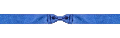 Symmetric blue bow knot on narrow silk ribbon Stock Photography