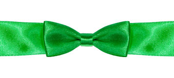 Symmetric bow knot on green satin ribbon close up Royalty Free Stock Photos