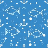 Symmetric  marine seamless pattern pastel colors for desig. Seamless symmetric pattern of white fish, anchors and small bubbles on a blue background. The pattern Stock Photo