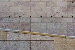 Symmetric modern achitecture stone facade path railing of public. Symmetrical horizontal vertical angled lines of stone tiles of modern architecture facade of Stock Image