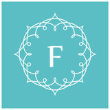 Symmetric monogram. Contains elements sheets, lines, spirals, intersection circle point. In the center of the letter F Stock Photo
