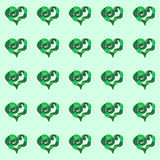 Symmetric pattern with hearts.  Green hearts on a blue background. Stock Photography