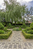 Symmetric plant arragement in garden. With the paved path and boxwoods Royalty Free Stock Photography